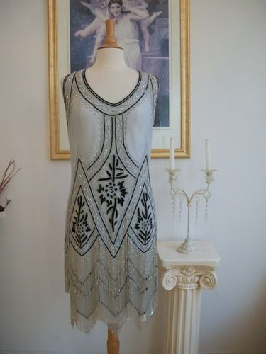 I treasure my collection of vintage flapper dresses - this reproduction would be a perfect addition and I wouldn't have to worry about ruining it!