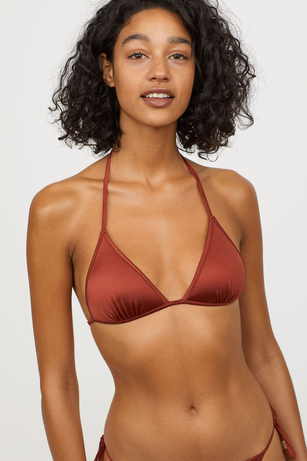 bf3f90acca15c Dark orange. Lined triangle bikini top with lightly padded, molded  underwire cups. Ties at neck and back.