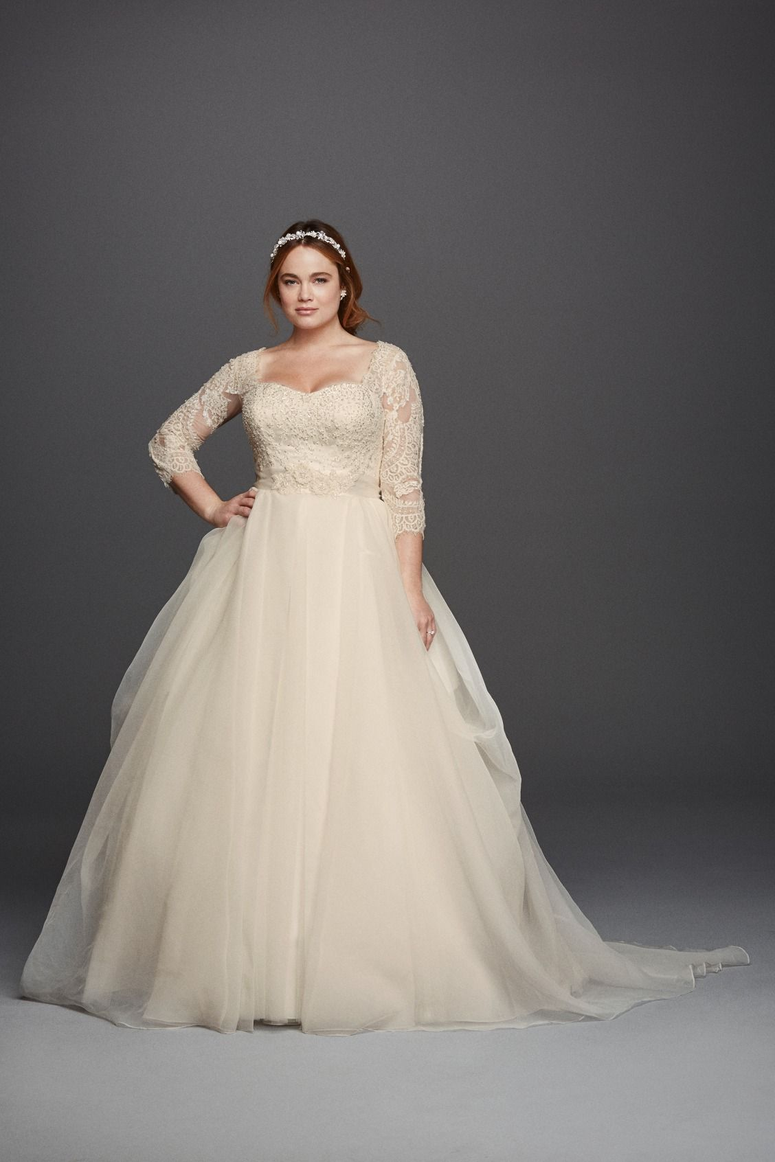 Wedding dresses for plus size brides  Oleg Cassini Plus Size threequarter lace sleeves and a flattering