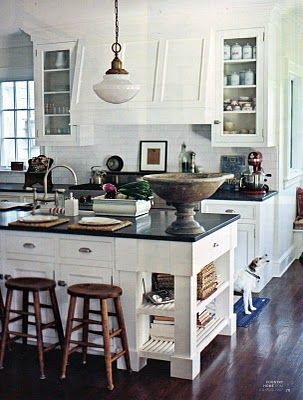beautiful kitchen. interesting that they placed barstools in front of cabinets where there is no counter overhang. no commitment there. You know...just in case we decide that barstools at an island or peninsula are no longer the thing to do.