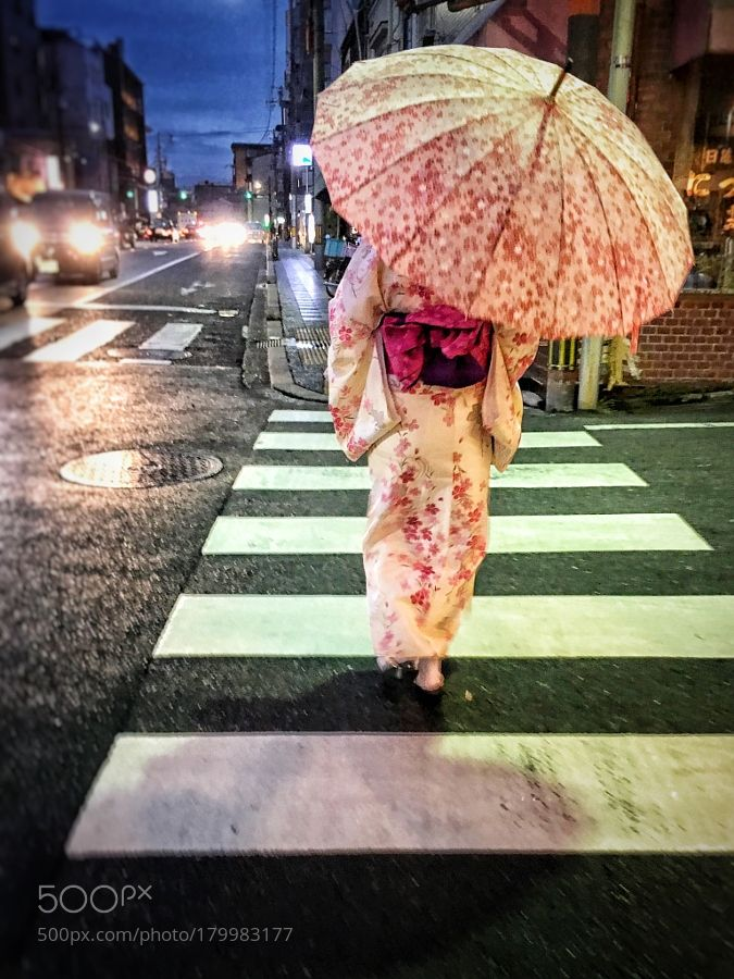 Colourful crossing - a girl in a kimono crosses the road in Gion Kyoto by af8