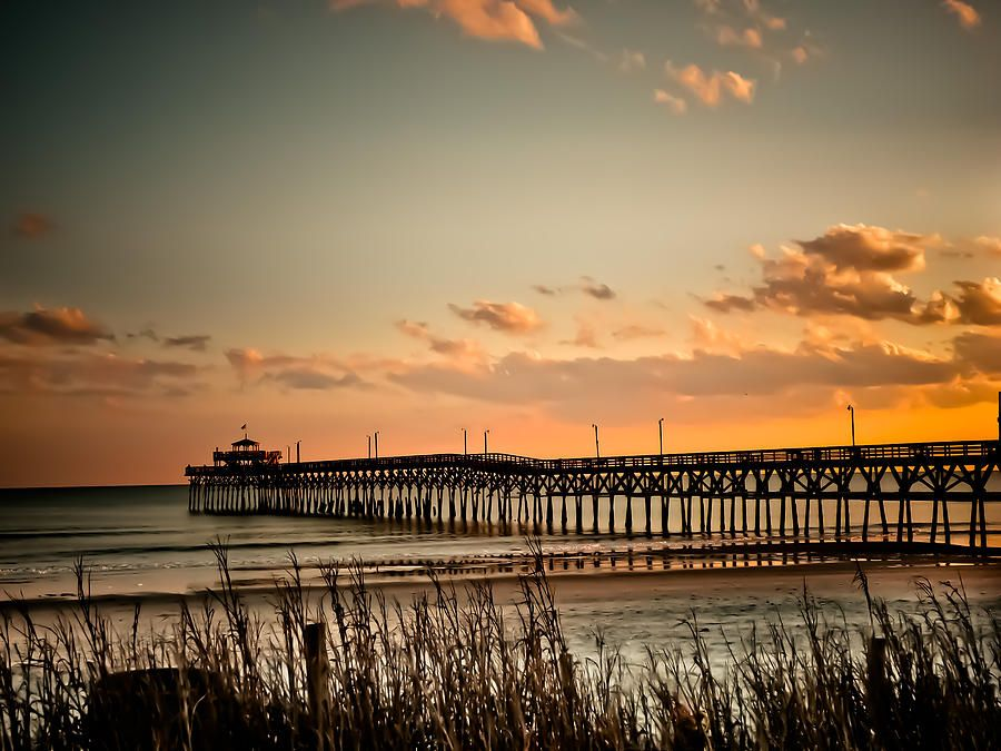 Experience gorgeous sunsets at the cherry grove pier on for Pier fishing myrtle beach