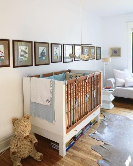 David Bagosy Fantastic Boy S Nursery Design With Modern Crib Gray Cowhide Rug Brown Gallery Frames Blue Green Bedding White Geometric Stool