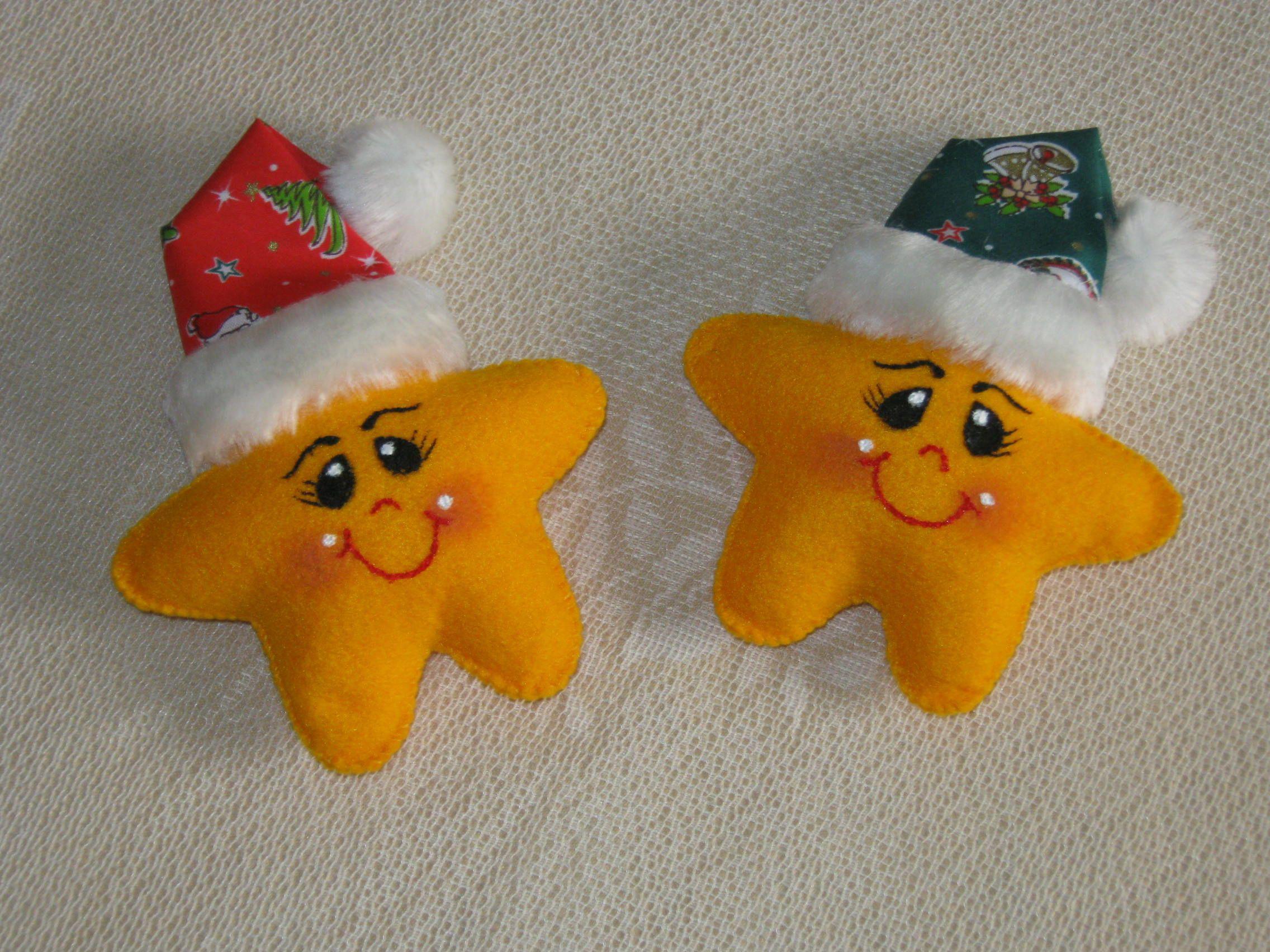 Dos estrellas navide as hechas con pa o lency con detalles