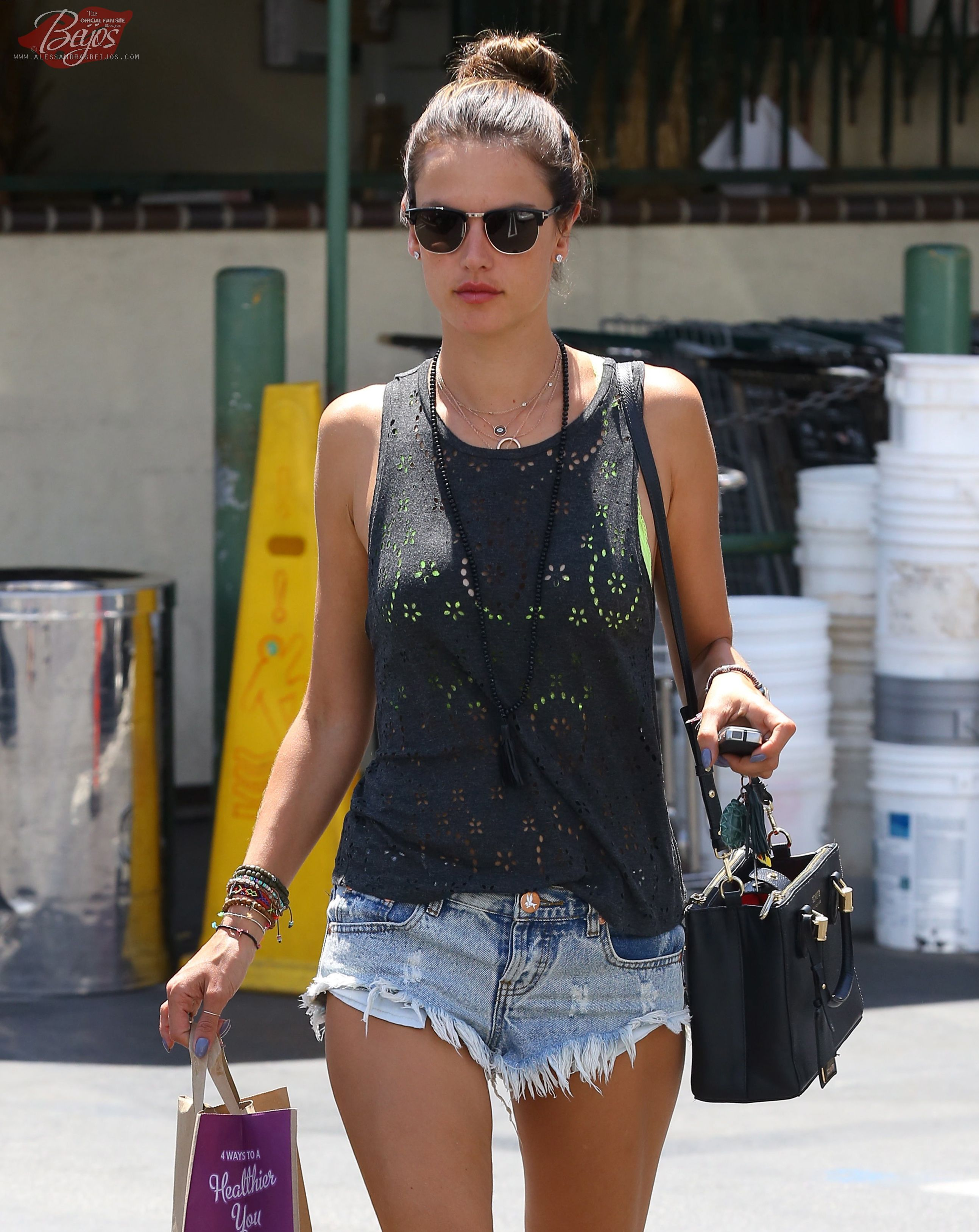 Alessandra Ambrosio stops to check her phone while out shopping along  Montana Ave in Santa Monica, California on May 1, 2014 8cf0b2497c92