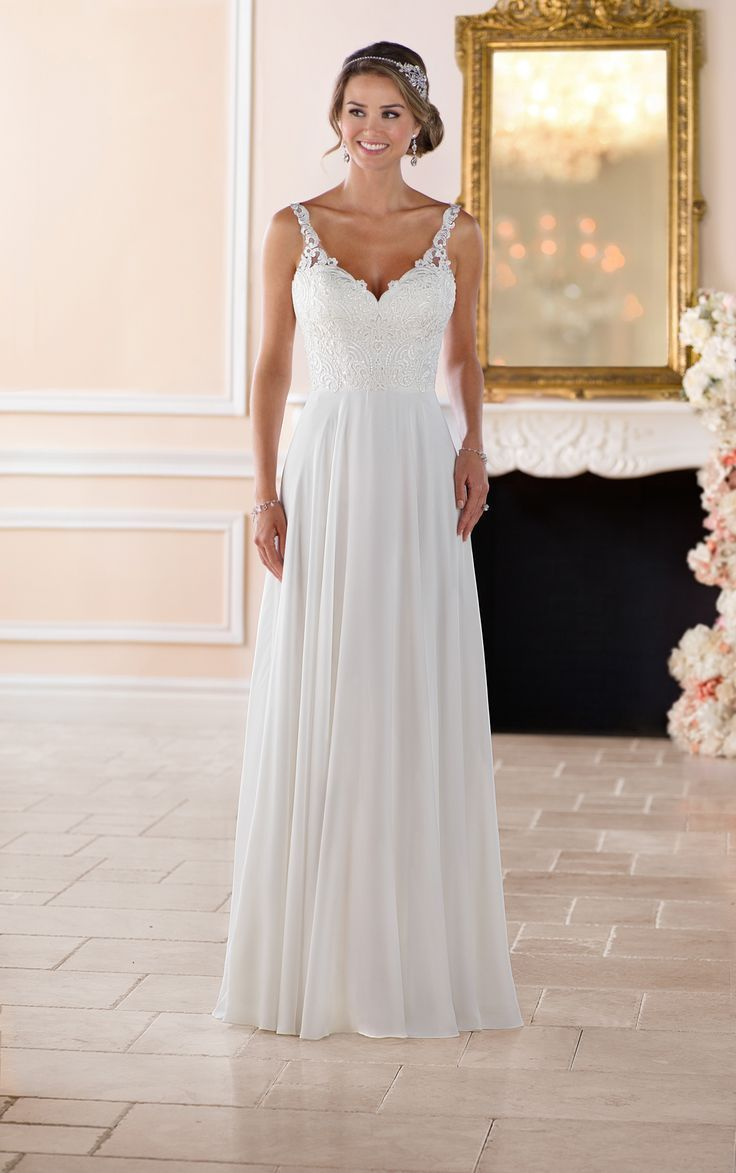 From stella york this flowy beach wedding dress is a simple yet