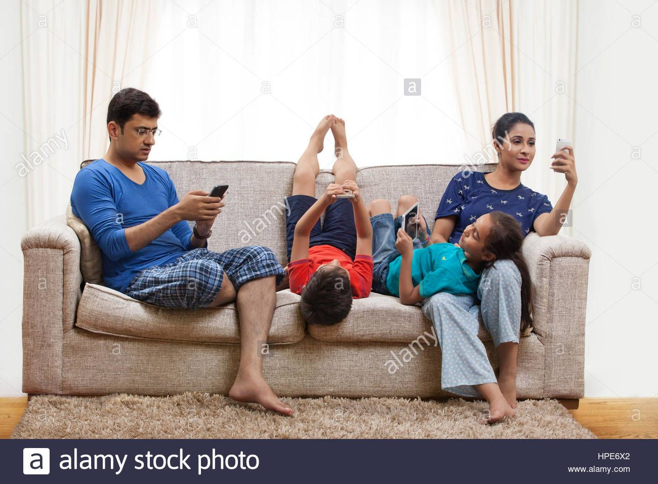Download this stock image: Family using cell phones and ...