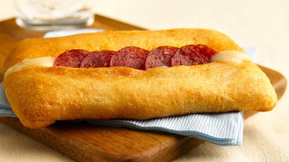 Spicy pepperoni and melted mozzarella peek through the top of these easy-to-eat pizza sandwiches.