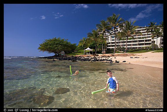 Children On Puu Poa Beach And Princeville Hotel