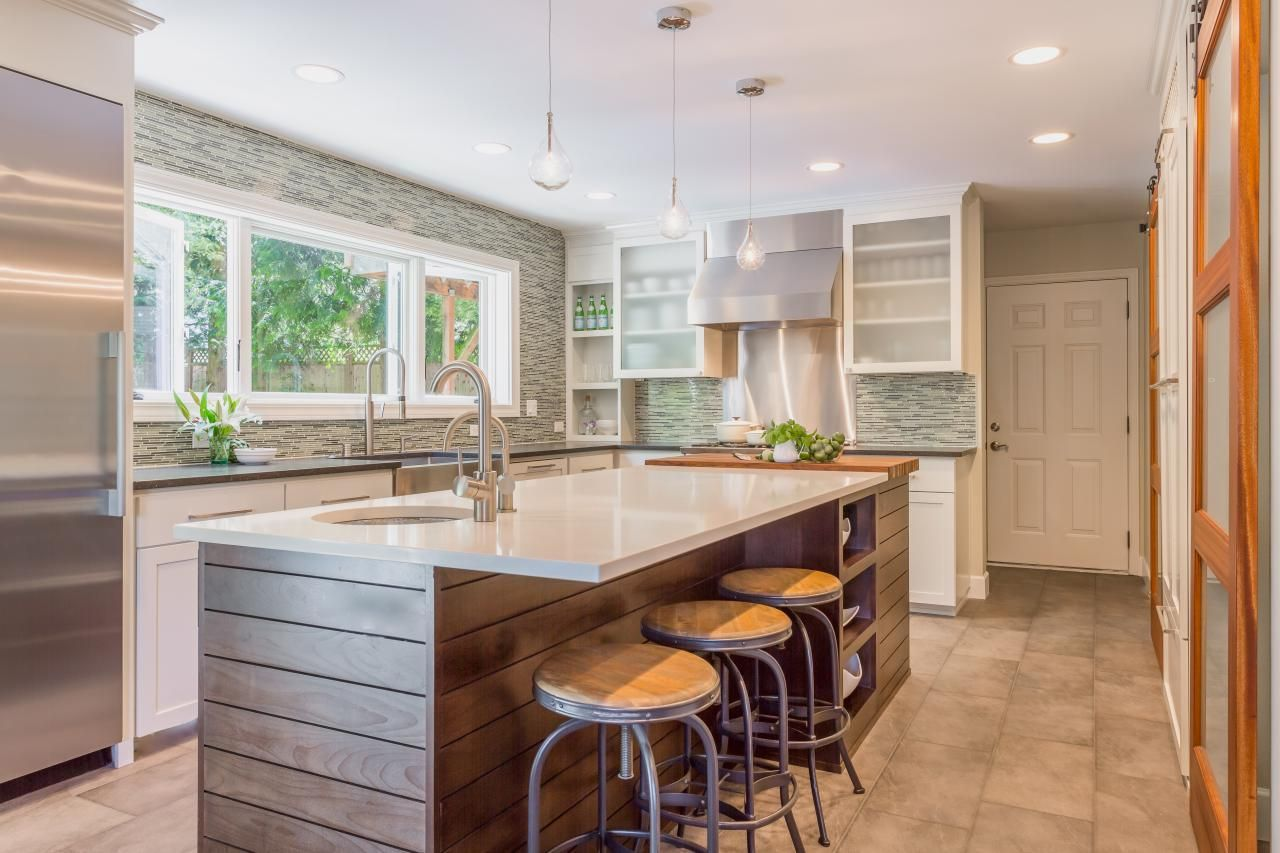 Lovely Wood Paneling Wraps Around This Large Kitchen Island Topped