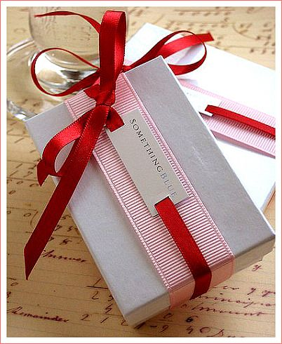 Ribbon, slider, different patterns and a box Adorable gift packing