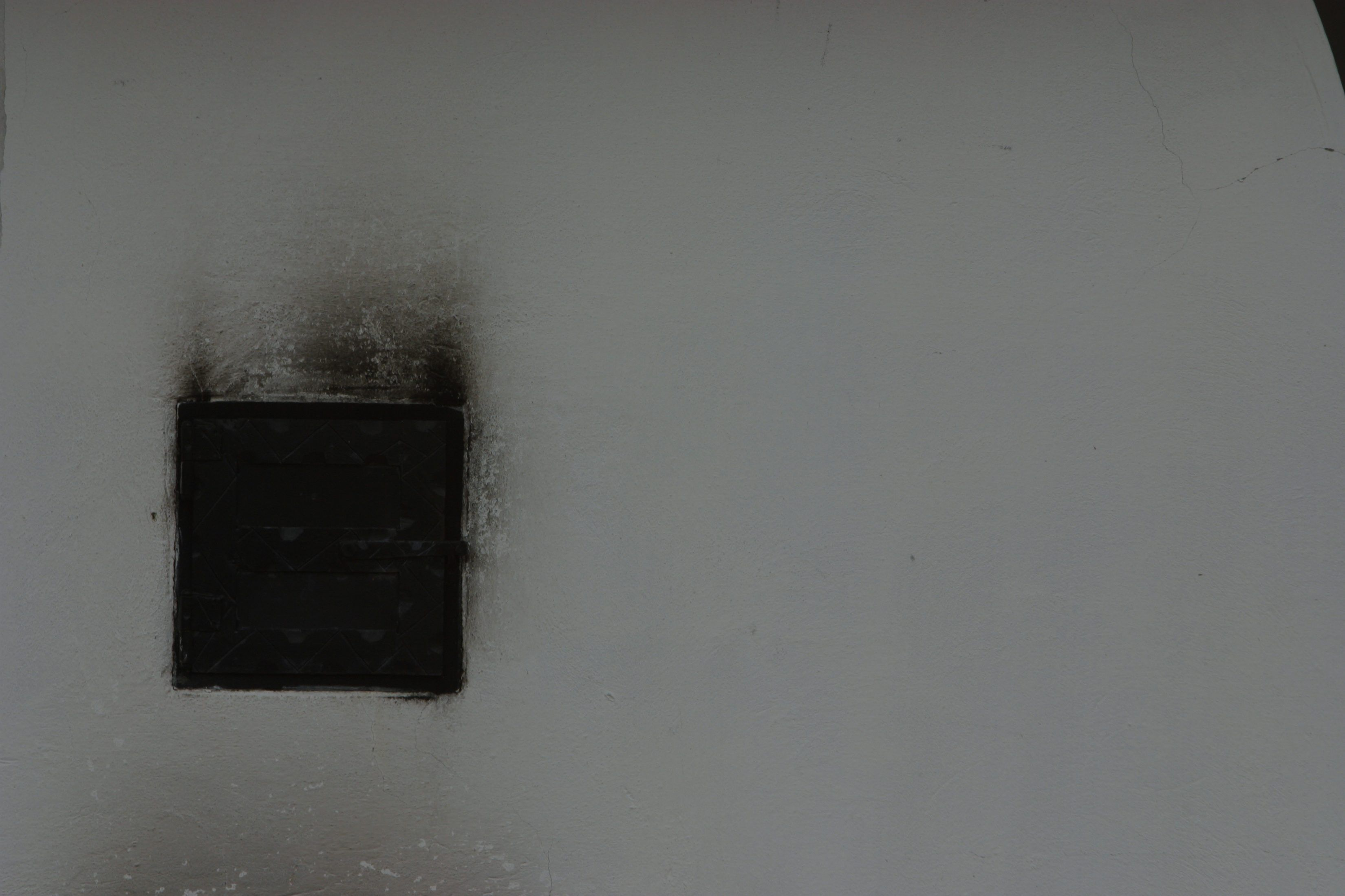 Black Smoke Stain Off Of A Painted Wall