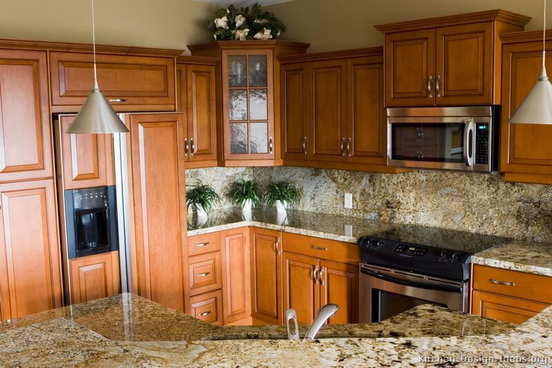 Traditional Medium Wood Golden Kitchen Cabinets From Kitchen Design Ideas Org Dark Wood Kitchen Cabinets Brown Kitchen Cabinets Kitchen Design