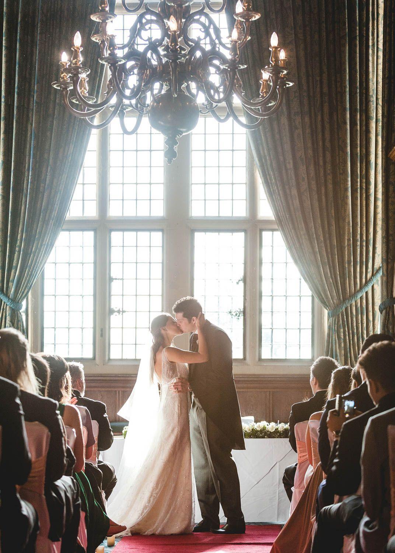 Wedding Kiss,  Rhinefield House Hotel, photography by Natalia Slepokur