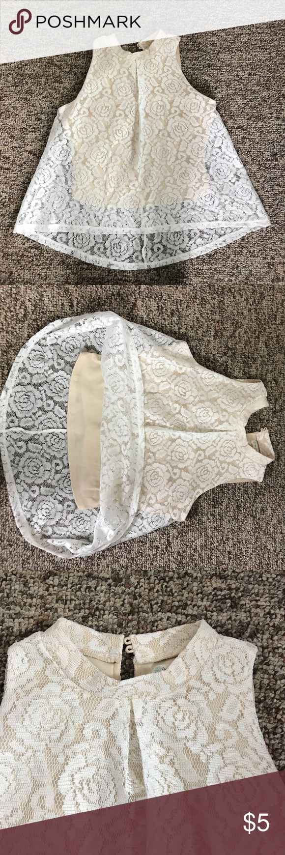 White flower patterned lace tank top with collar A white laces tank top with a cream liner. The white lace is a flower pattern and goes down farther than the cream inside liner does. The tank top is love, fire and is a size S Love, Fire Tops Tank Tops