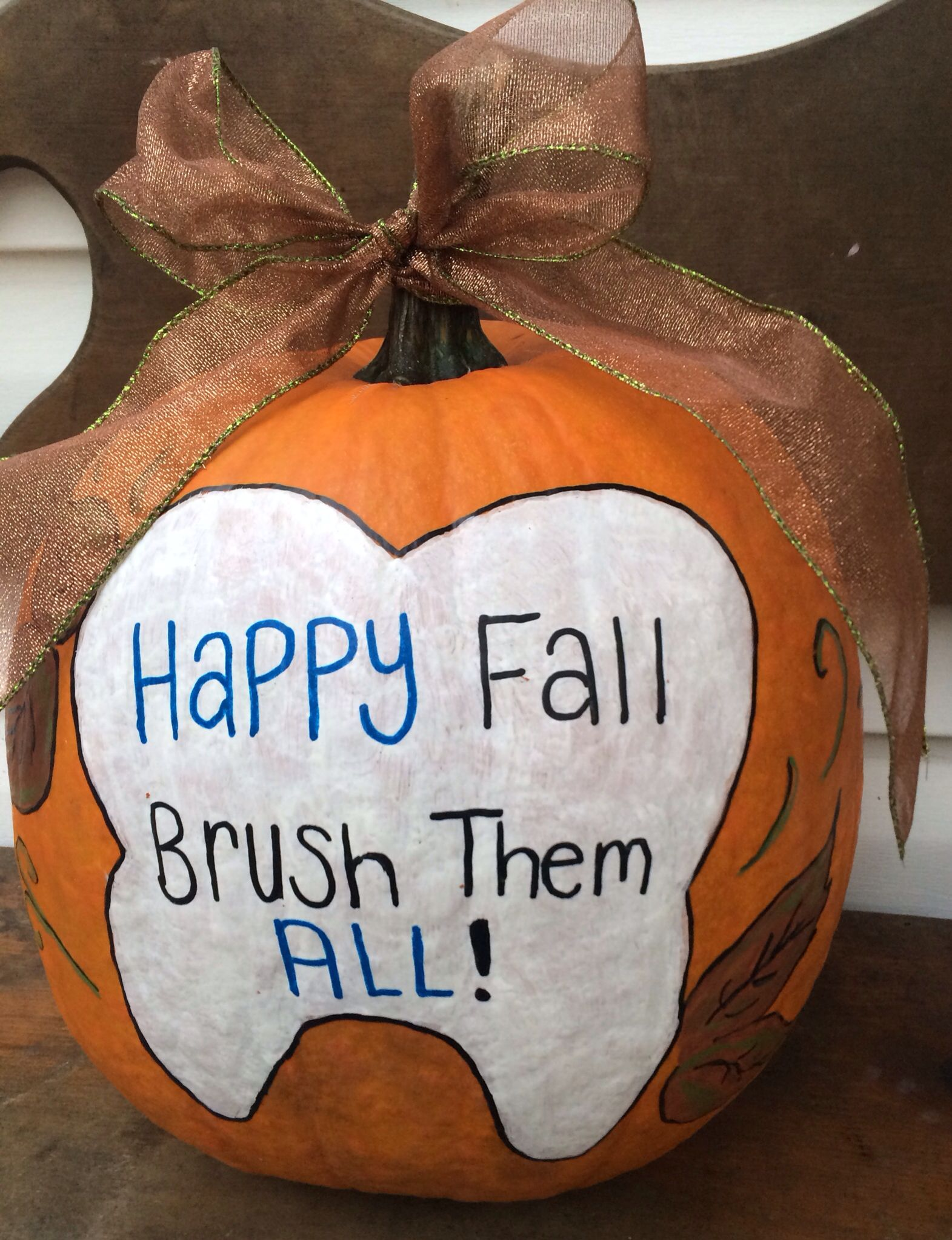 "another cute ""brush them all"" pumpkin idea for dental office decor"