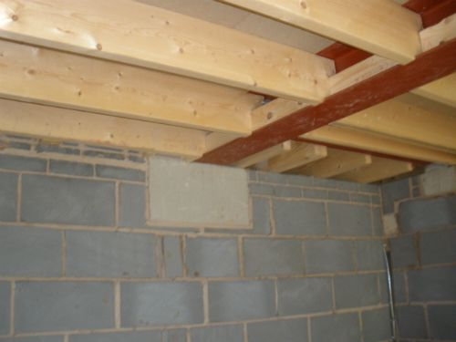 Steel Beam Supporting Floor Joists Bearing Onto A Padstone