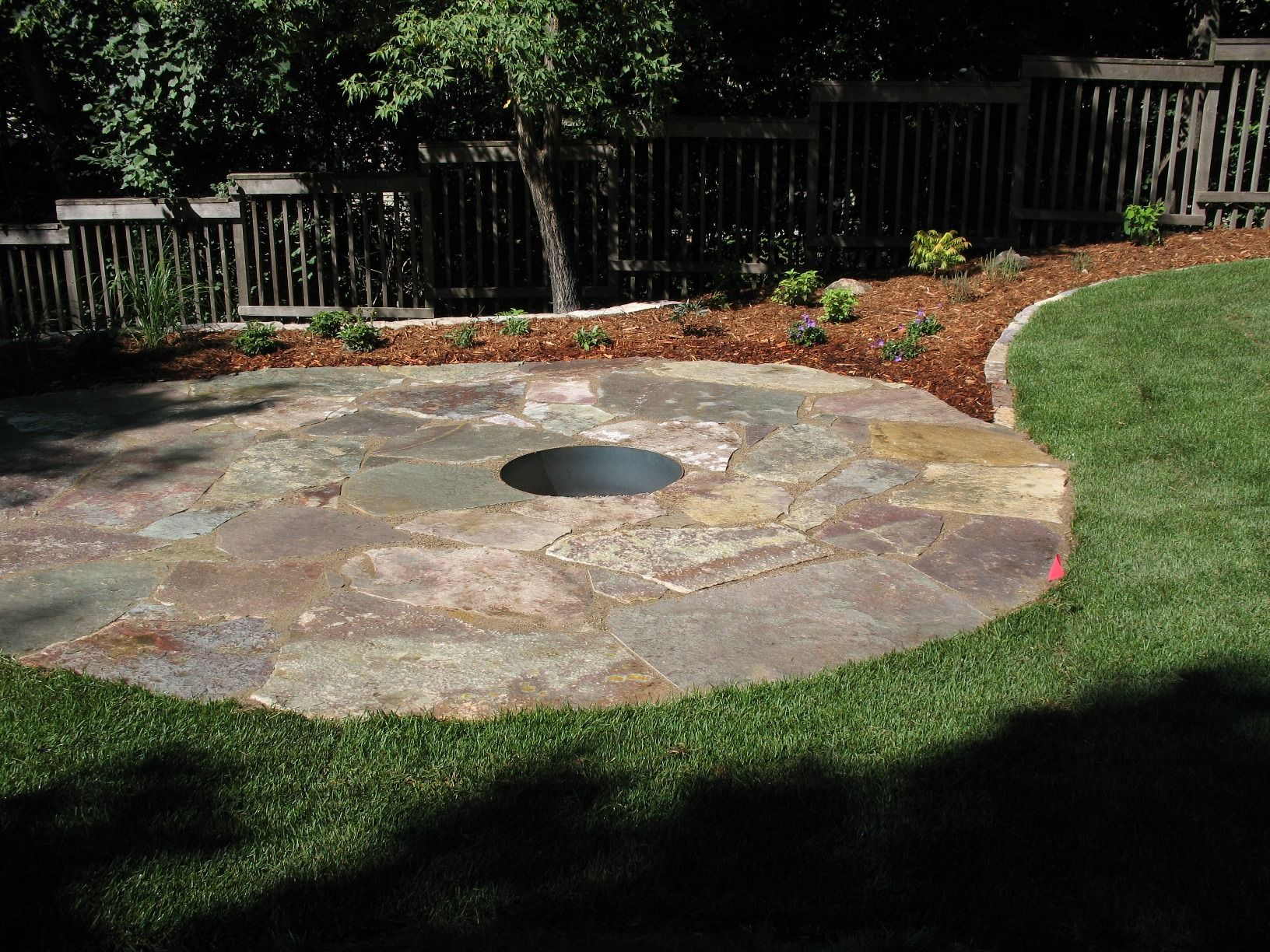 flagstone patio with fire pit. A Chilton Irregular Flagstone Patio With 30\u0027\u0027 Fire Ring And Border Edging Installed By Barrett Lawn Care. #patio #firepit Pit M