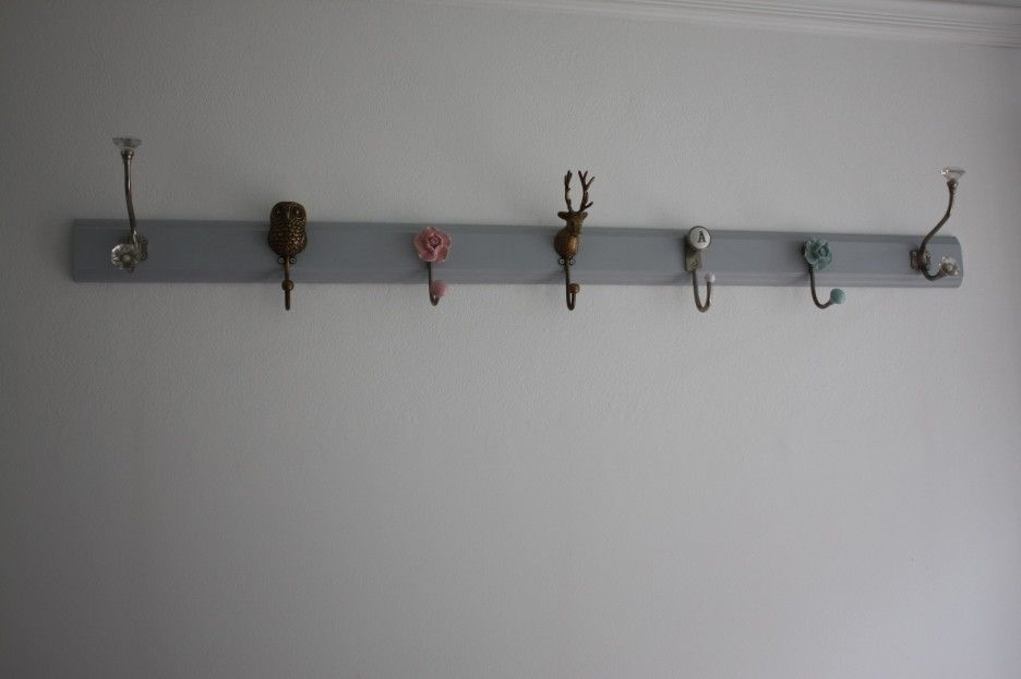 Interior. gray polished wooden board wall mounted coat hanger with ...