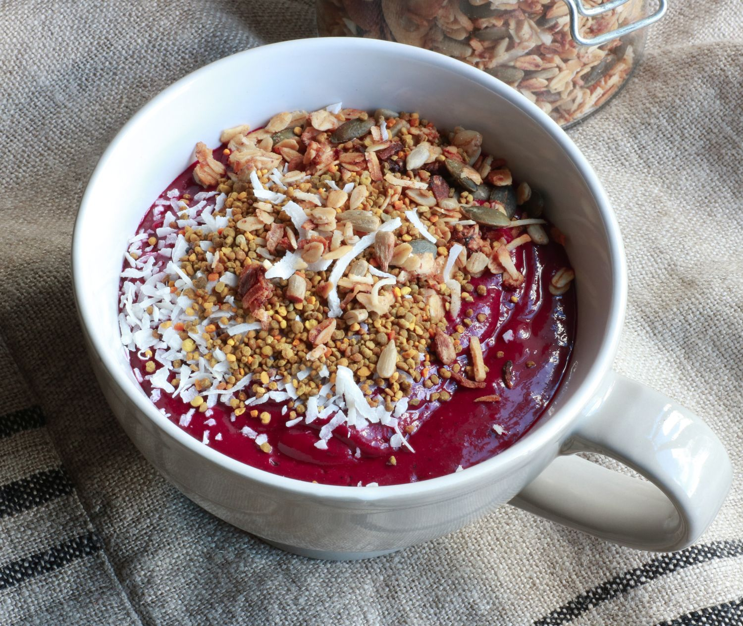 Brazillian Acai Berry Bowl — Wholefood Nosh 1 ripe banana  2 slices of beetroot  1 tbsp chia seeds  1/2 cup almond milk  1/4 cup water  a few cubes of ice  1 tbsp of Acai berry powder (I like Matakana Superfoods or Organic Burst)   1 tsp of pure maple syrup (optional)  Toppings  Banana Cinnamon Granola  Raw bee pollen (this is usually available at organic or health food stores)