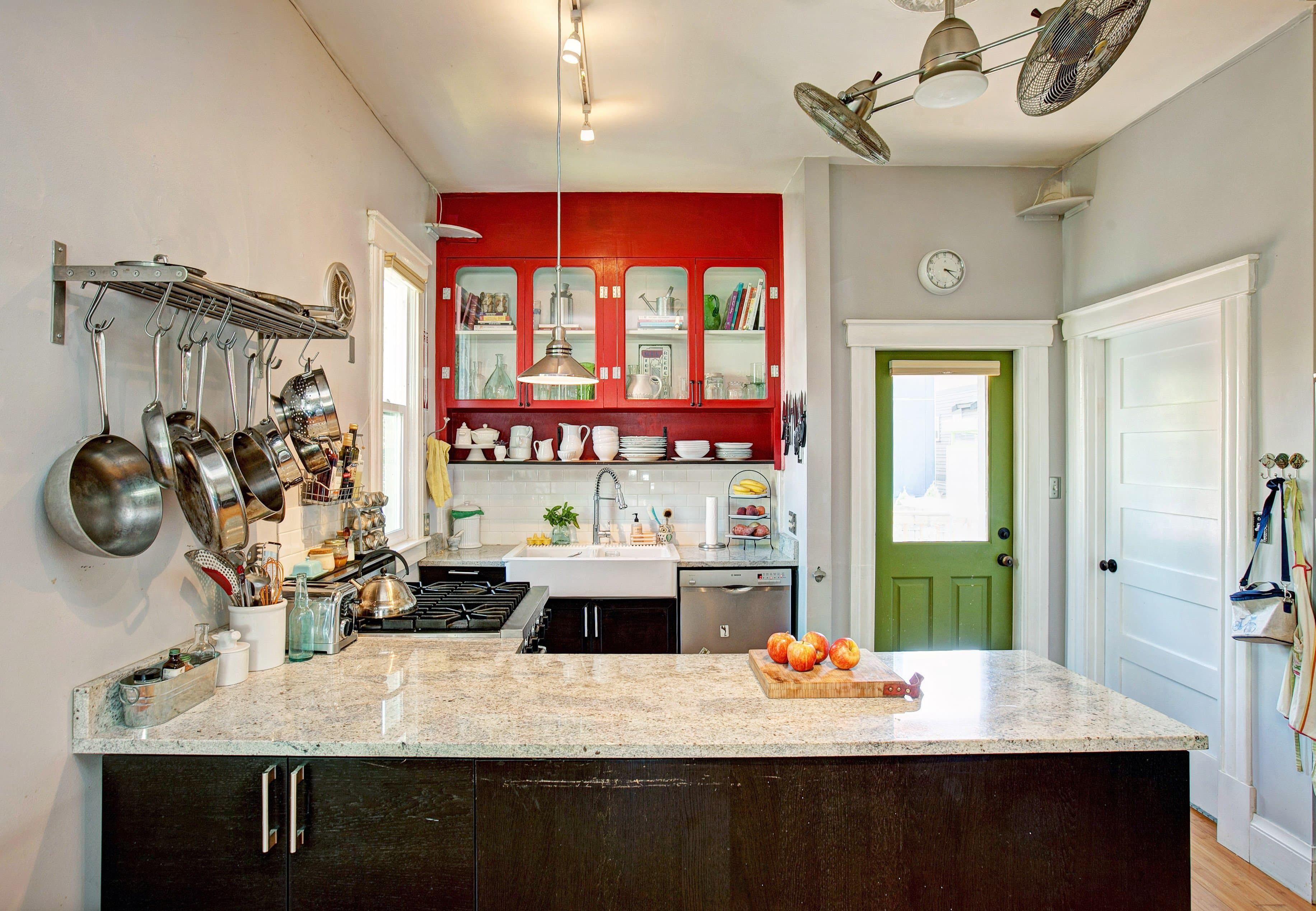 gorgeous red cabinets steal the show in this seattle kitchen