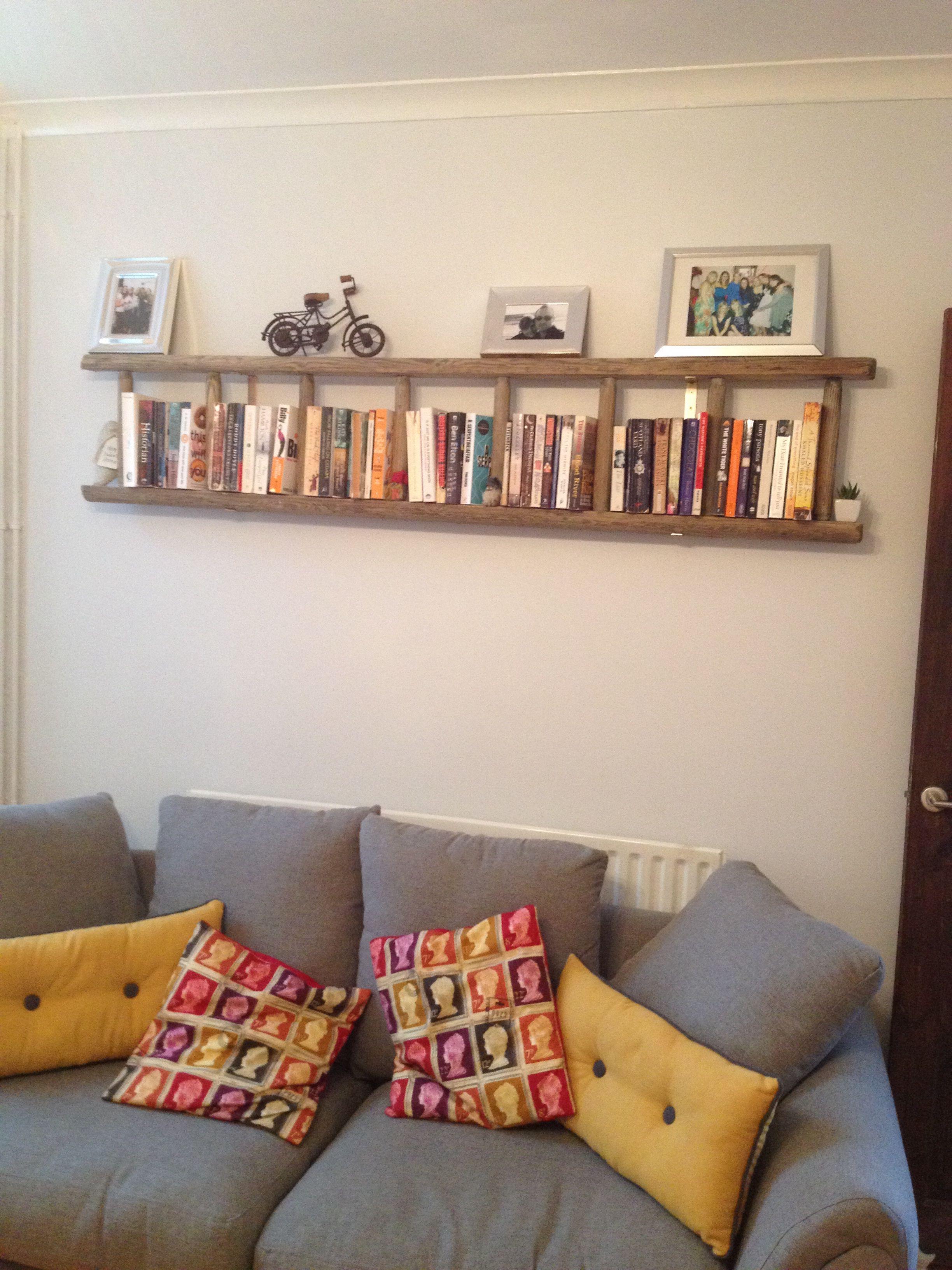 Vintage ladder bookcase walls and art arrangements in