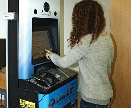A Patron Renews Her Driver S License Inside Ames Iowa Public Library In June Iowa Dot Unveiled 11 Kiosks In Libraries In Ma Library Ames Iowa Public Library
