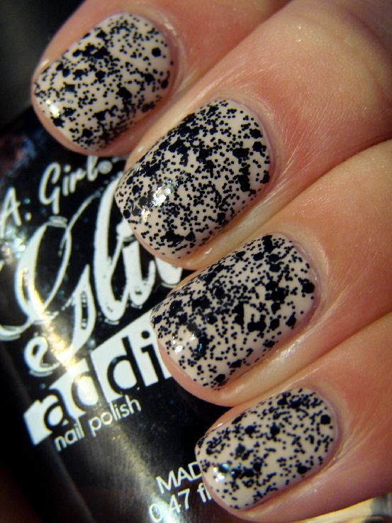 nude polish with black glitter