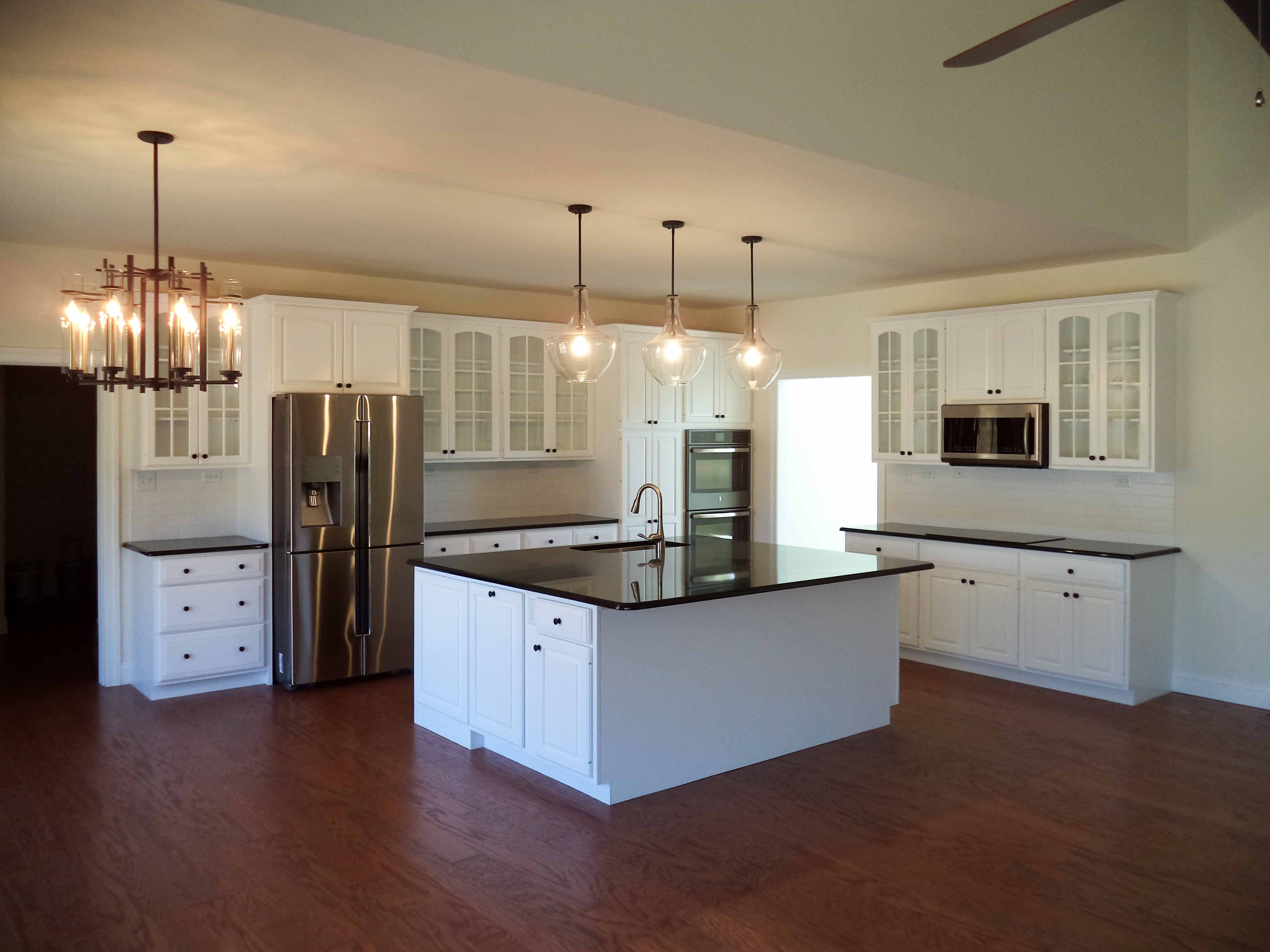 The kitchen of a Musser II-Maple cabinets in Glacier White ... on Maple Cabinets With White Granite Countertops  id=19757