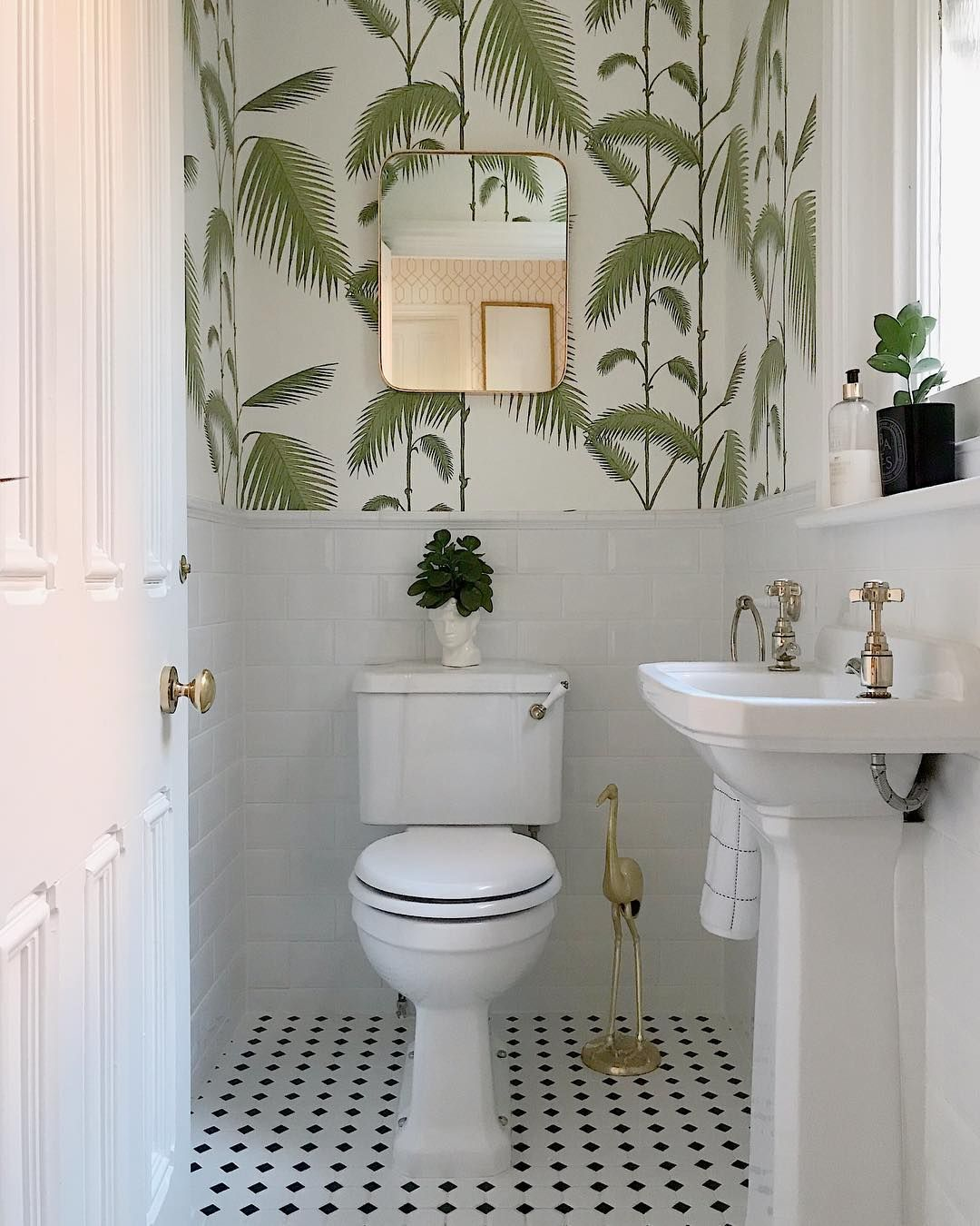 A Beautiful White Bathroom With Gold Accessories And Botanical Wallpaper To Add Character Bathro Bathroom Wallpaper Modern Downstairs Toilet Wallpaper Toilet