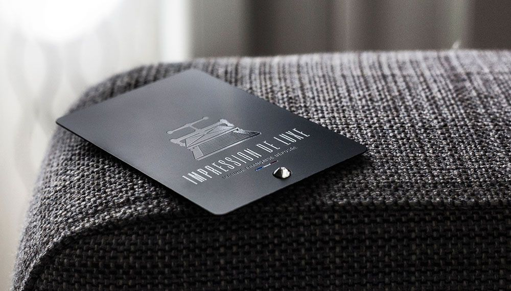 A sample of an Impression de Luxe namecard, studded with a Swarovski - business report sample
