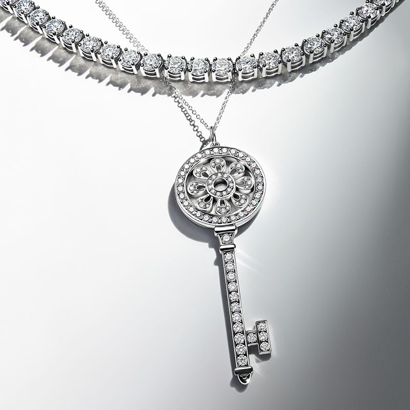 dfcc8f08111d Line necklace and Tiffany Keys petal key pendant in platinum with diamonds.