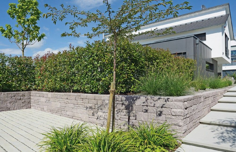 Funktionelles Gartenmauersystem für die Hangbefestigung oder als - garten sichtschutz mauer