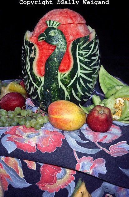 Carved watermelon swan shape apples grapes honeydew