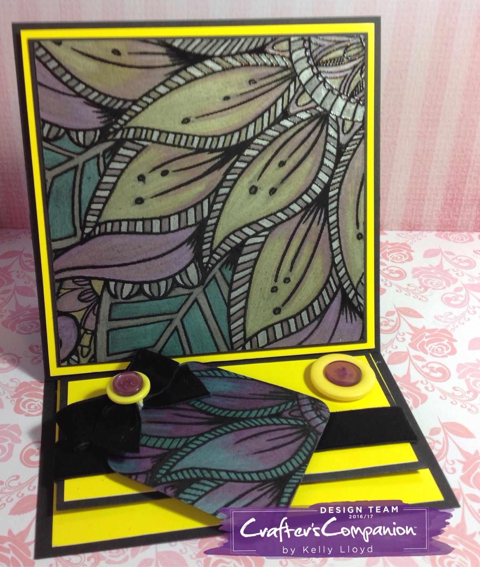 Easel card using Spectrum Noir colorista dark exquisite florals pad Coloured with spectrum noir metallic pencils. violet, pink, green, yellow, nickel and silver. Designed by Kelly Lloyd #crafterscompanion #spectrumnoir #spectrumnoircolorista #adultcolouring