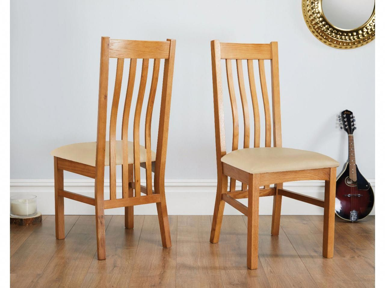These Farmhouse solid oak dining chairs are made from sustainable American oak and e with a cream leather seat pad rockingchairpads