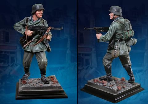 World War II German Army CS60004 German Unteroffizier Statue - Made by The Collectors Showcase Military Miniatures and Models. Factory made, hand assembled, painted and boxed in a padded decorative box. Excellent gift for the enthusiast.