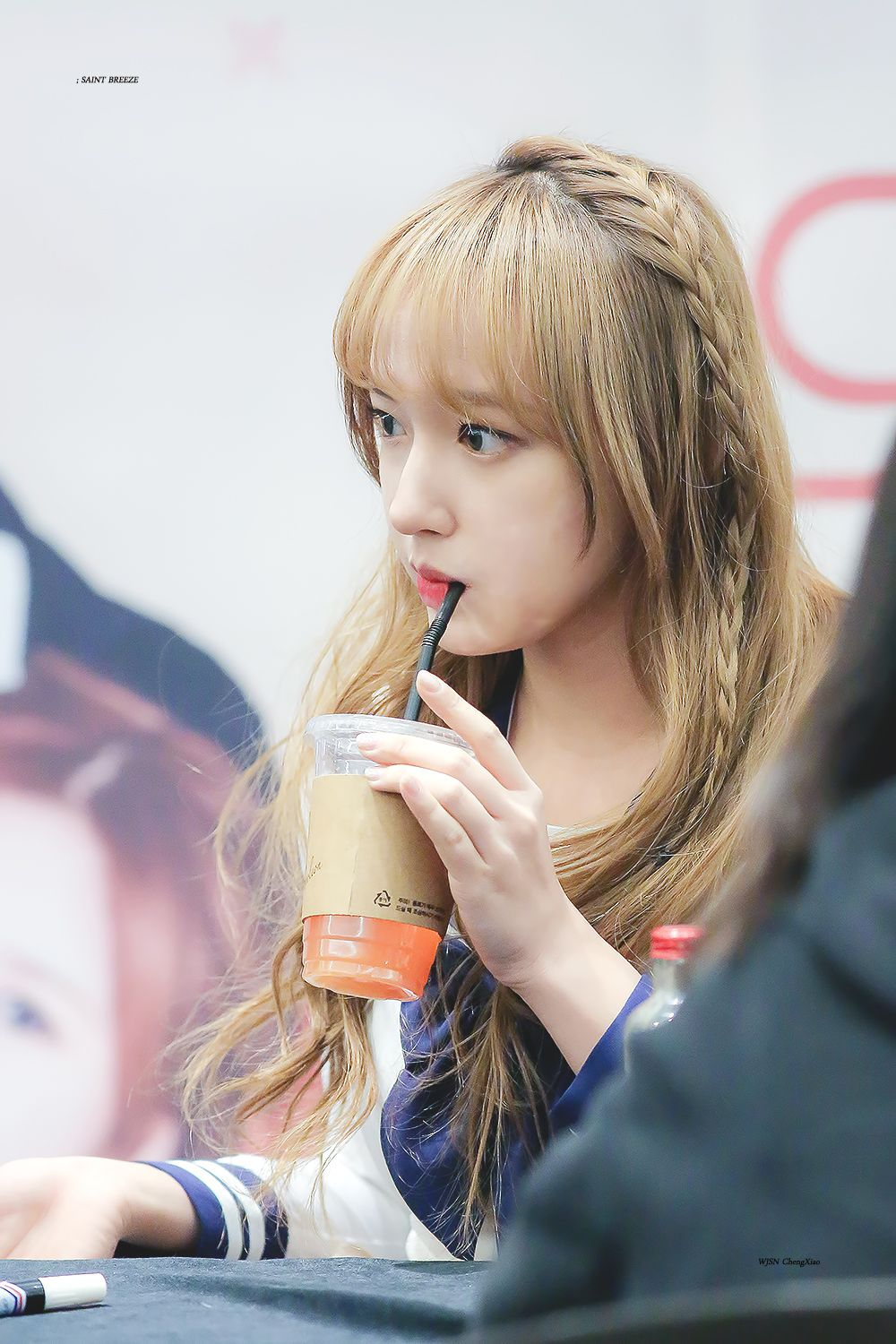 Cheng Xiao Drinking Coffee Juice