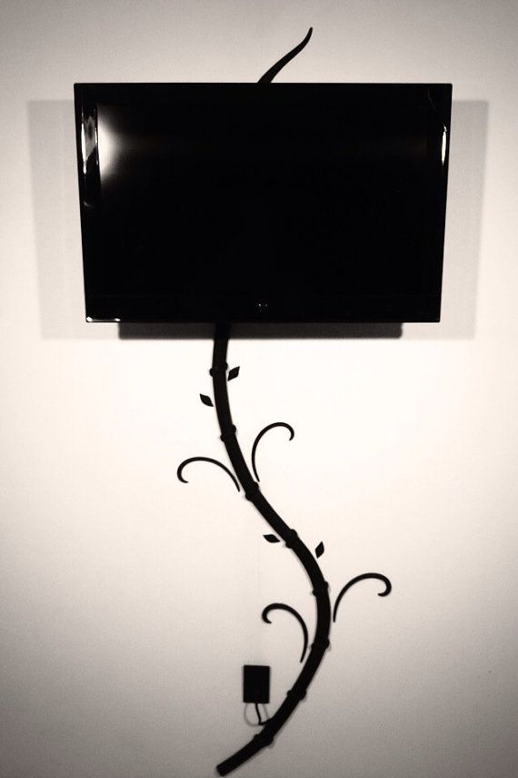 hide tv and digital picture frame cords without cutting holes in your wall with my creation the tvtree wall decals to distract