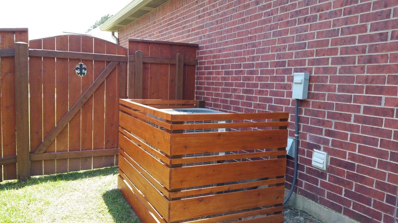 Air conditioning enclosure made from cedar fence boards