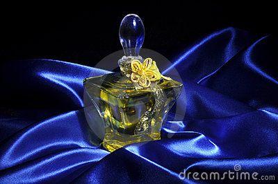 Perfume over of wavy blue satin