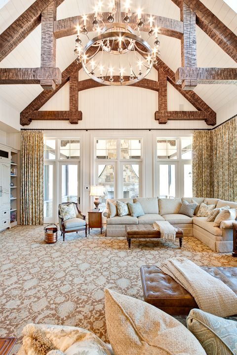 French Country Keeping Room with pine trusses, cypress tongue & groove walls, custom cabinetry, chandelier and large doors to patio.  Cardinal Construction, Inc. - Duluth, GA