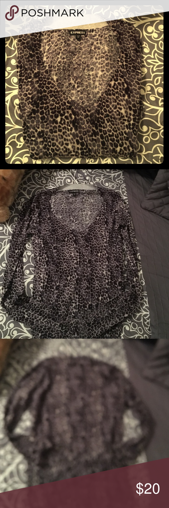 Leopard print sweater Express v neck leopard print sweater. Size small. Excellent condition. Always line dried it never put it in the dryer to make sure it didn't shrink. Express Sweaters V-Necks