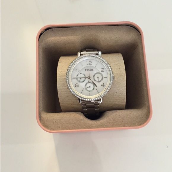 Fossil Silver Watch Fossil silver watch with diamonds (not real). Brand new, never worn. No links have been taken out so it can be adjusted to personal preference. Includes tags and original box. Fossil Jewelry