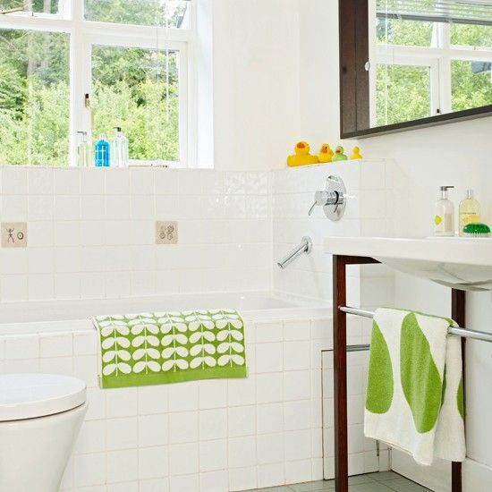 White bathroom with green accents - like the square tiles