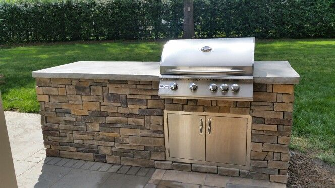 Concrete counter top with rock face built in grill for Built in barbecue grill ideas