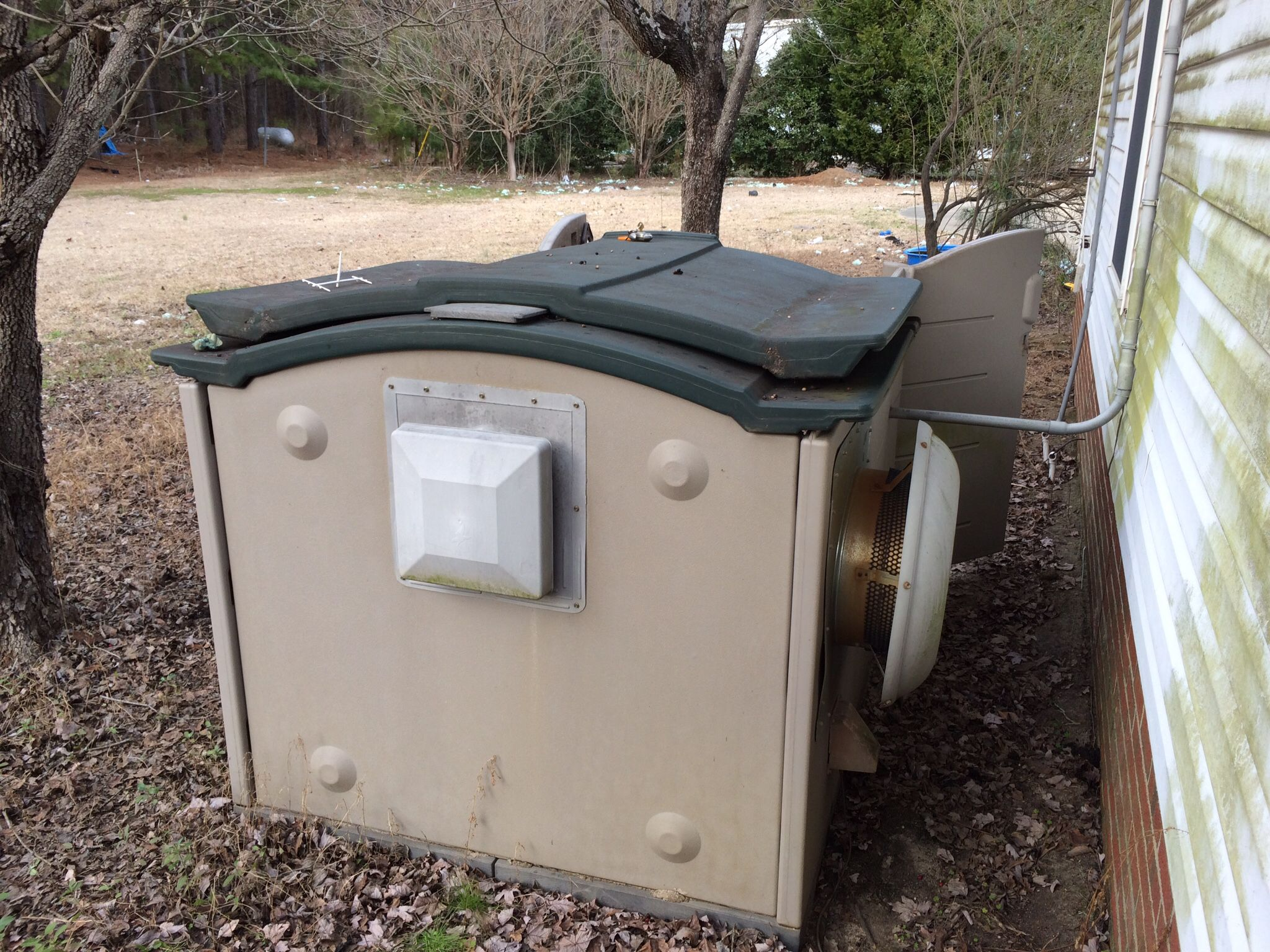 Back end of rubbermaid garden tractor house converted to