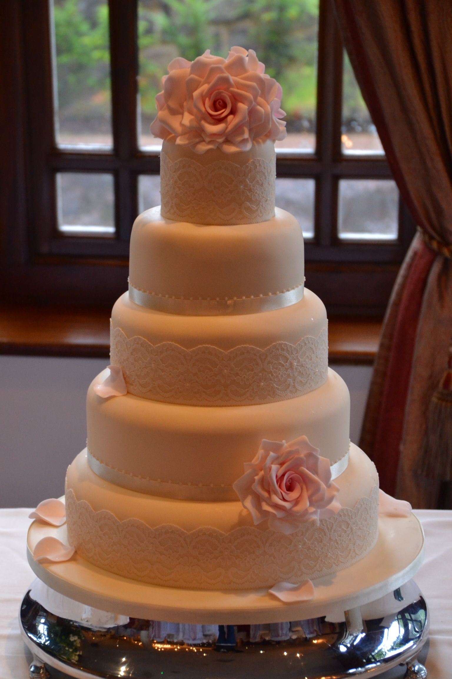 5 tier vintage wedding cake with sugar iced roses and lace