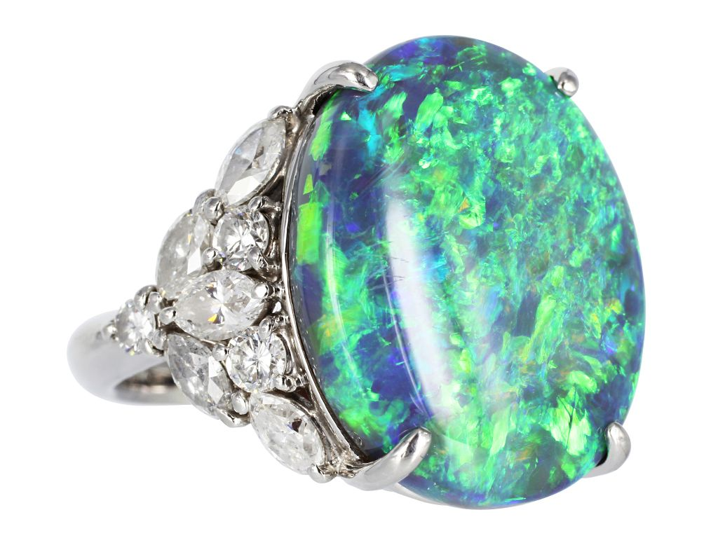 Platinum ring consisting of 1 oval cut black opal weighing 15.33 carats measuring approximately 21.5 x 18 mm and flanked on each side by a cluster design of 10 marquise and 6 round cut diamonds having a total weight of 2.20 carats.