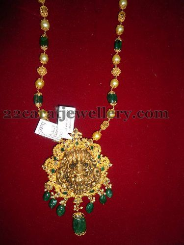 Jewellery Designs: Emerald Drops Set with Lord Krishna